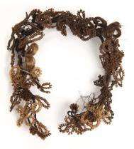 This wreath is made of hair from various people (based on the different colors).