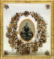A wreath made of the hair of the family members in the photo most likely.
